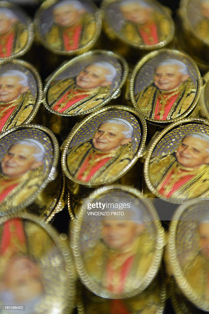 Souvenirs with portraits of Pope Benedict XVI are displayed in a shop near the Vatican after it was announced that Pope Benedict XVI will resign on February 11, 2013. Pope Benedict XVI on February 11, 2013 announced he will resign on February 28, a Vatican spokesman told AFP, which will make him the first pope to do so in centuries.