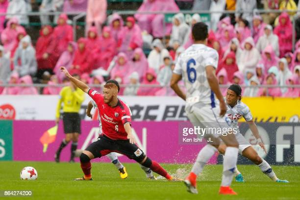 Souza of Cerezo Osaka and Yusuke Tanaka of Ventforet Kofu compete for the ball during the JLeague J1 match between Cerezo Osaka and Ventforet Kofu at...