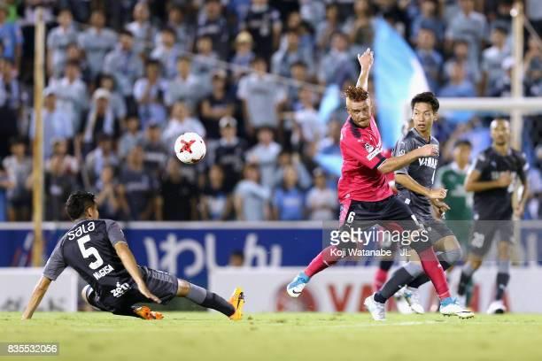Souza of Cerezo Osaka controls the ball under pressure of Nagisa Sakurauchi and Hayao Kawabe of Jubilo Iwata during the JLeague J1 match between...