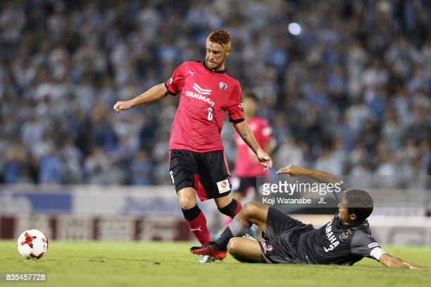 Souza of Cerezo Osaka is tackled by Kentaro Oi of Jubilo Iwata during the JLeague J1 match between Jubilo Iwata and Cerezo Osaka at Yamaha Stadium on...