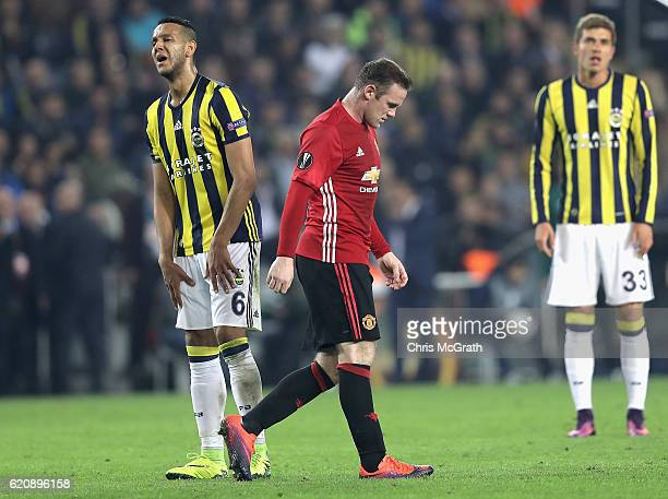 Souza of Fenerbahce looks on as Wayne Rooney of Manchester United walks back to his own half after scoring his sides first goal during the UEFA...