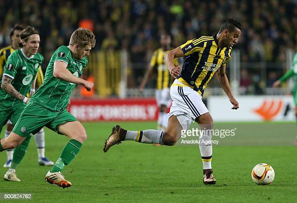 Souza of Fenerbahce vies for the ball with Stuart Armstrong of Celtic during the UEFA Europa League Group A soccer match between Fenerbahce SK and...