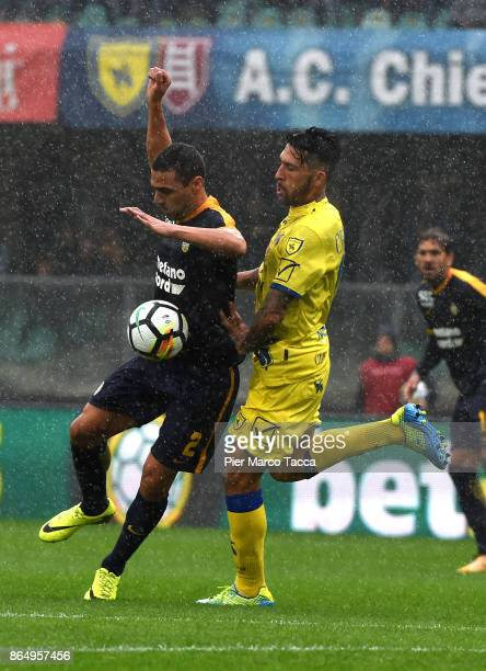 Souza Orestes Romulo of Hellas Verona competes for the ball with Lucas Castro of AC Chievo Verona during the Serie A match between AC Chievo Verona...