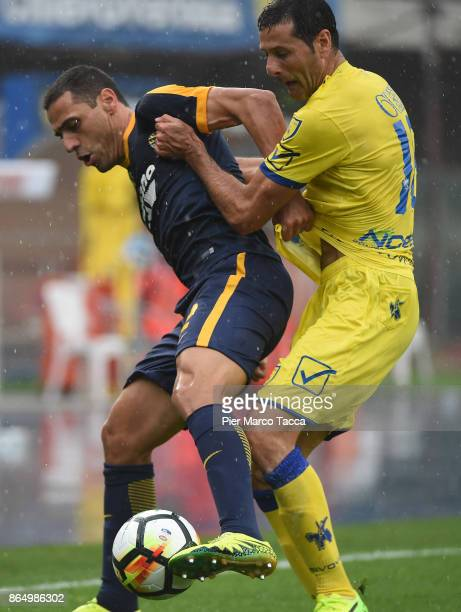 Souza Orestes Romulo of Hellas Verona competes for the ball with Massimo Gobbi of AC Chievo Verona during the Serie A match between AC Chievo Verona...