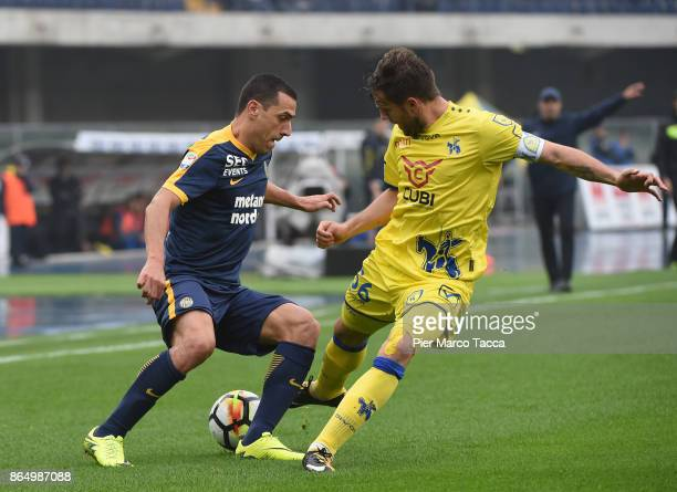 Souza Orestes Romulo of Hellas Verona competes for the ball with Perparim Hetemaj of AC Chievo Verona during the Serie A match between AC Chievo...