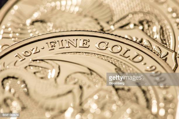 Sovereign gold bullion coins sit on display at The Royal Mint in Llantrisant UK on Thursday March 23 2017 Britain's Royal Mint is making 15 billion...