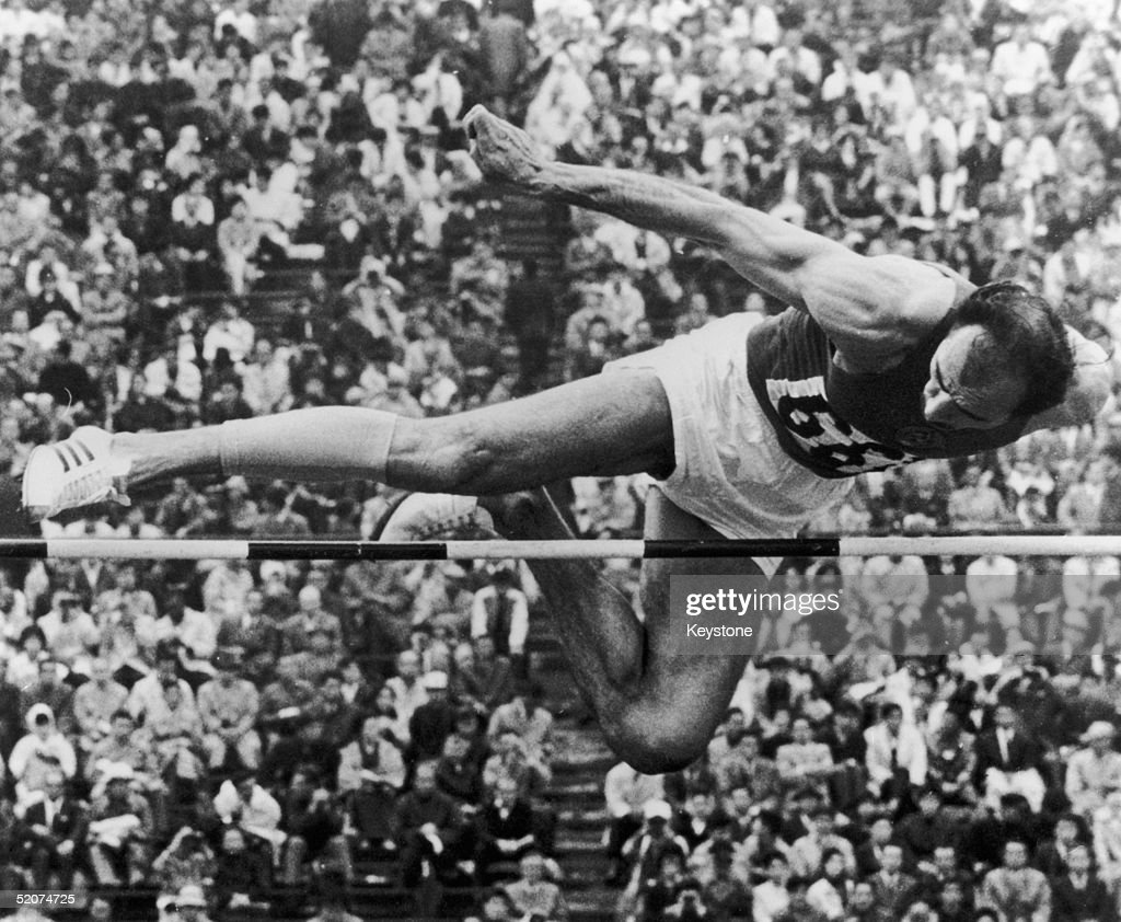 Soviet athlete Robert Shavlakadze clears the bar during the High Jump event at the Olympic Games in Tokyo, 17th October 1964, where he finished fifth. He won the gold medal in 1960 in Rome.