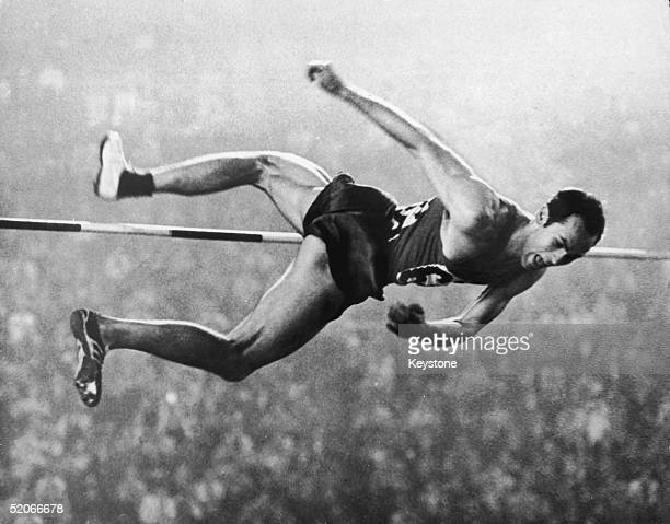 Soviet athlete Valery Brumel clears the bar at 2m18 in the High Jump event during the Olympic Games in Tokyo 21st October 1964 Brumel set six world...