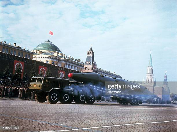 A Soviet ballistic missile rolls by the Kremlin during a parade celebrating the 50th anniversary of the Bolshevik Revolution