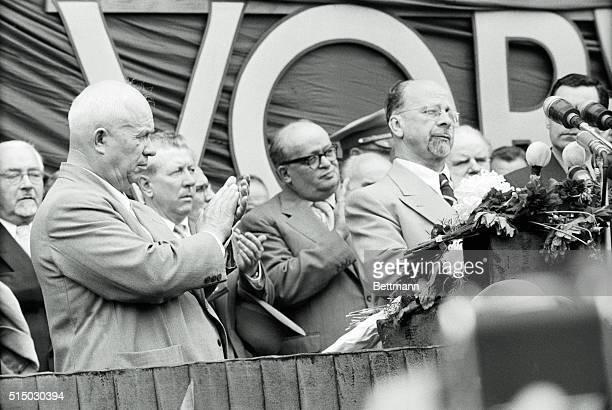 Soviet communist leader Nikita Khrushchev applauds the speech of East Germany's communist leader Walter Ulbricht on Khurshchev's arrival in East...