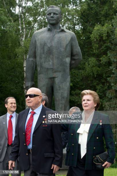 Soviet cosmonauts the first woman in space Valentina Tereshkova and the first man to make a space walk Alexei Leonov walk past a monument to Yuri...