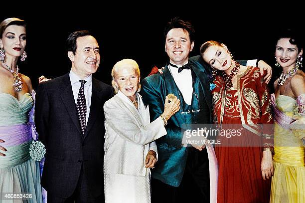 Soviet designer Slava Zaitsev receives medal of the city of Paris from Jean Tiberi with Carmen De Tommaso also known as Madame Carven after the...