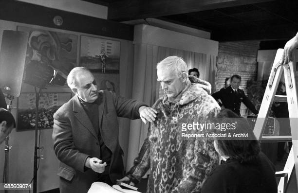 Soviet director Michail Konstantinovic Kalatozov fixing Scottish actor Sean Connery's costume on the set of The Red Tent 1969