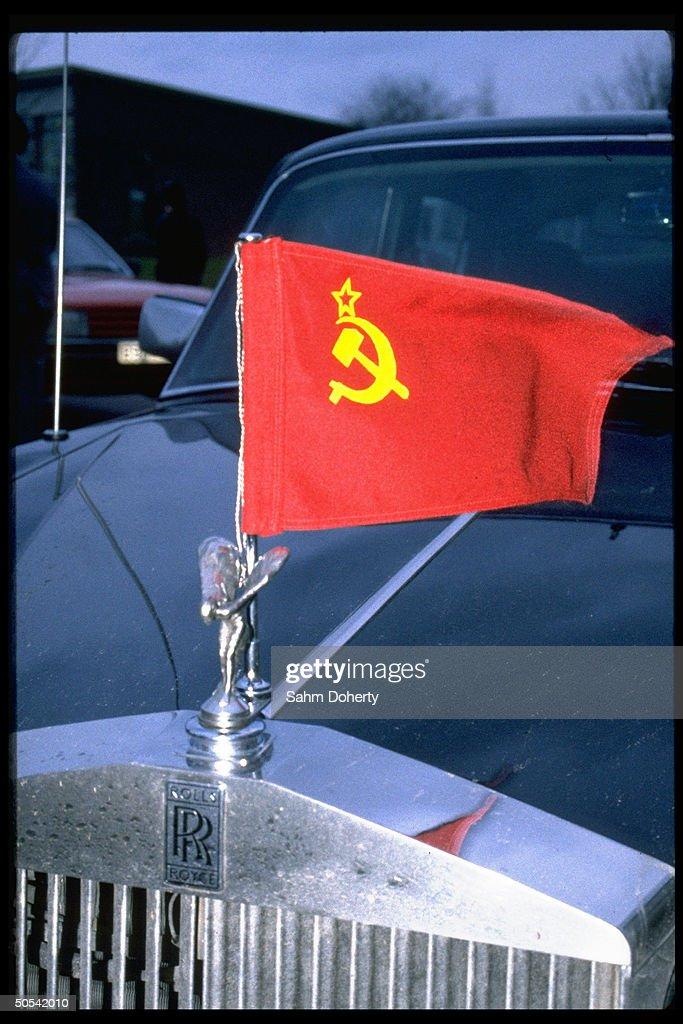 Soviet flag flying fr Rolls Royce auto during visit fr Soviet Politburo member Mikhail Gorbachev