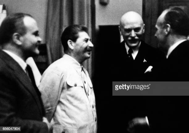 Soviet head of state Joseph Stalin and his Foreign Minister Vyacheslav Molotov speak with German Nazi Foreign Minister Joachim Von Ribbentrop on 23...