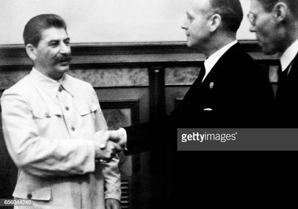 Soviet head of state Joseph Stalin shakes hands with German Nazi Foreign Minister Joachim Von Ribbentrop on 23 August 1939 in Kremlin in Moscow after...