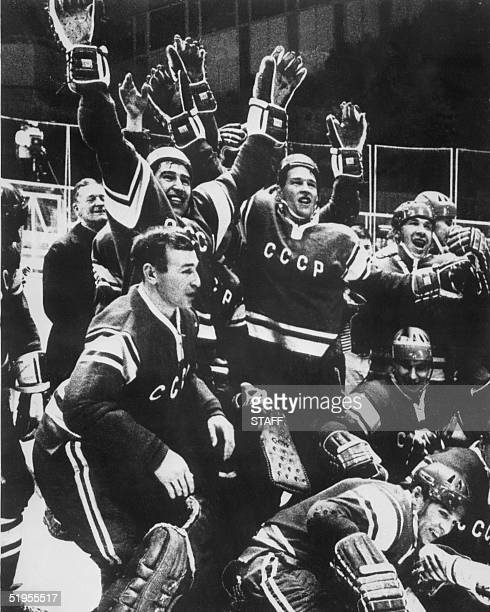 Soviet ice hockey players celebrate after defeating Canada 50 in the final 17 February 1968 in Grenoble during the Winter Olympics The USSR retains...