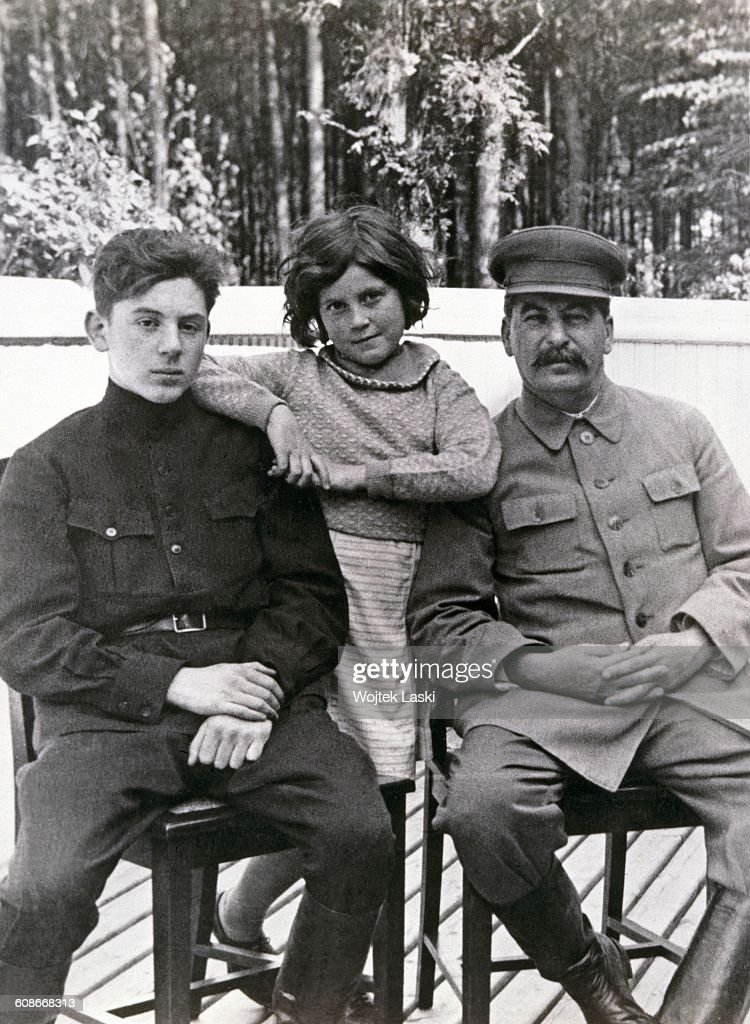 Soviet leader <a gi-track='captionPersonalityLinkClicked' href=/galleries/search?phrase=Joseph+Stalin&family=editorial&specificpeople=91259 ng-click='$event.stopPropagation()'>Joseph Stalin</a> (1878 - 1953, right) with his son, Vasily (1921 - 1962) and daughter Svetlana (1926 - 2011) at one of Stalin's dachas, former Soviet Union, June 1935. Both children are by Stalin's second wife, Nadezhda Alliluyeva. The photograph was taken by Stalin's head of personal security, Nikolai Vlasik (1896 - 1967).