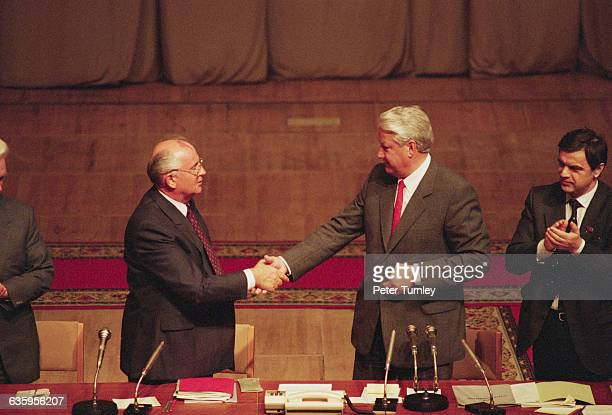 Soviet leader Mikhail Gorbachev and Boris Yeltsin shake hands during a meeting after the failed coup d'etat in 1991