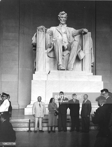 Soviet leader Nikita Khrushchev and his wife Nina Khrushcheva along with several unidentified others stand nest to the Lincoln Memorial while on a...