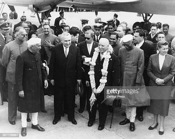 Soviet military officer Kliment Voroshilov meeting Indian Prime Minister Jawaharlal Nehru and Indian President Rajendra Parasad upon his arrival in...