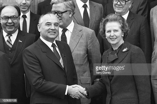 Soviet Politburo member Mikhail Gorbachev shakes hands with British Prime Minister Margaret Thatcher at Chequers on December 16 1984