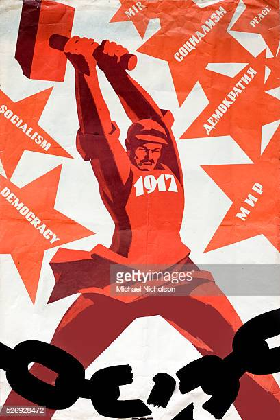 Soviet poster commemorating the October Revolution of 1917 Shows a worker shattering his chains the poster also shows symbols of democracy socialism...