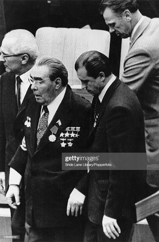 Soviet premier <a gi-track='captionPersonalityLinkClicked' href=/galleries/search?phrase=Leonid+Brezhnev&family=editorial&specificpeople=93686 ng-click='$event.stopPropagation()'>Leonid Brezhnev</a> (1906 - 1982, second from left) is lead from the podium by East German premier <a gi-track='captionPersonalityLinkClicked' href=/galleries/search?phrase=Erich+Honecker&family=editorial&specificpeople=209084 ng-click='$event.stopPropagation()'>Erich Honecker</a> (1912 - 1994, left) after Brezhnev announced unilateral troop strength reductions in a speech at the East German Palace of the Republic, East Berlin, 6th October 1979.