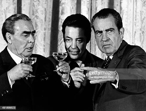 FILE Soviet premier Leonid I Brezhnev left examines how much President Richard M Nixon right has drunk while Viktor Sukhodrev center a Russian...