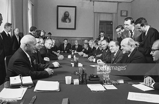 Soviet Premier Nikita Khrushchev and United States Secretary of State Dean Rusk hold the last of their discussions before the signing of the Nuclear...