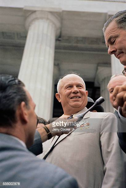 Soviet Premier Nikita Khrushchev listens as President Eisenhower is interviewed