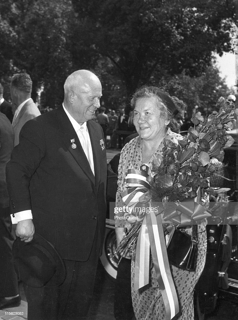 Soviet Premier Nikita Khrushchev (1894 - 1971) smiles at his wife, Nina Khrushcheva (1923 - 1971) as they arrive at Blair House, the US Government's official state guest house, Washington DC, September 1959.