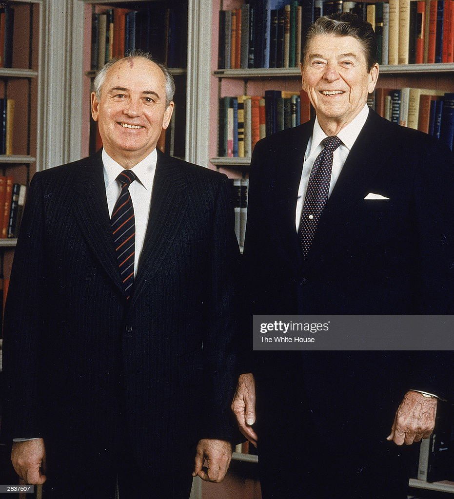Soviet President Mikhail Gorbachev American President Ronald Reagan pose together in the White House library Washington DC December 8 1987