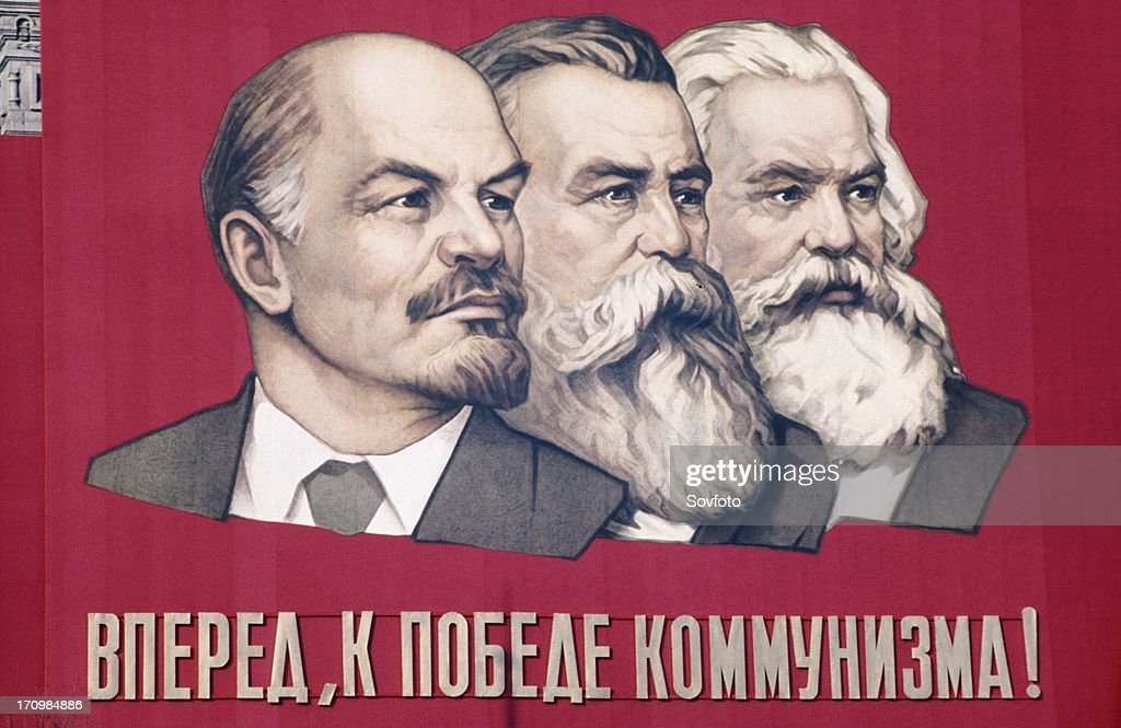 Soviet propaganda banner with likenesses of lenin engels and marx in leningrad ussr 1960s the banner reads 'forward to the victory of communism'