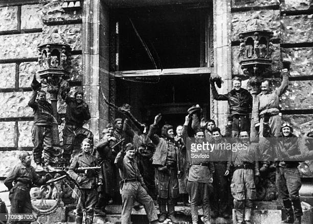 Soviet red army soldiers celebrating outside the reichstag building fall of berlin may 1945 world war 2