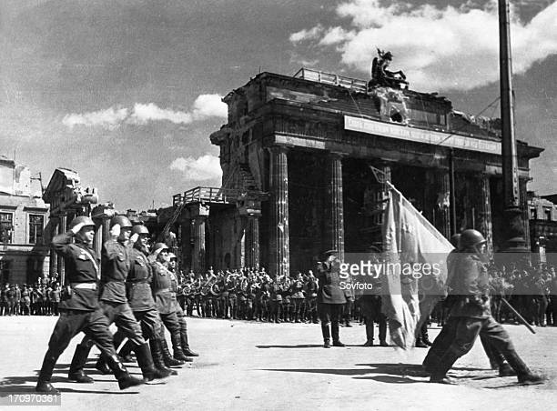 Soviet red army troops during a victory parade in front of the brandenburg gate in berlin germany at the end of world war 2 may 20 1945