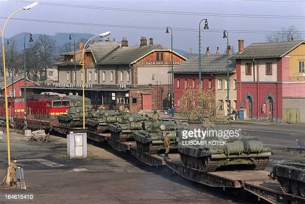 Soviet soldiers direct tank manoeuvres 26 February 1990 in Frenstat 350 kilometers east of Prague as the withdrawal of the first Soviet troops...