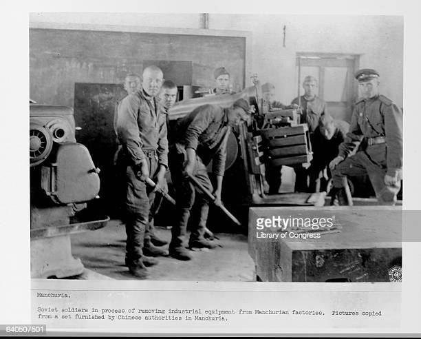 Soviet soldiers remove industrial equipment from a Manchurian factory China