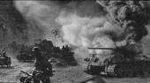 Soviet soldiers walk and drive past a burning T34 medium tank during the Battle of Kursk Russia July 1943 Although the conflict between the Soviet...