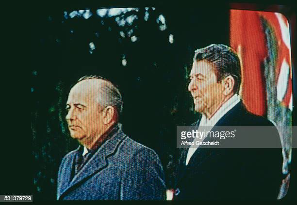 Soviet statesman Mikhail Gorbachev and US President Ronald Reagan on television USA 8th December 1987 They are attending a ceremony to welcome...