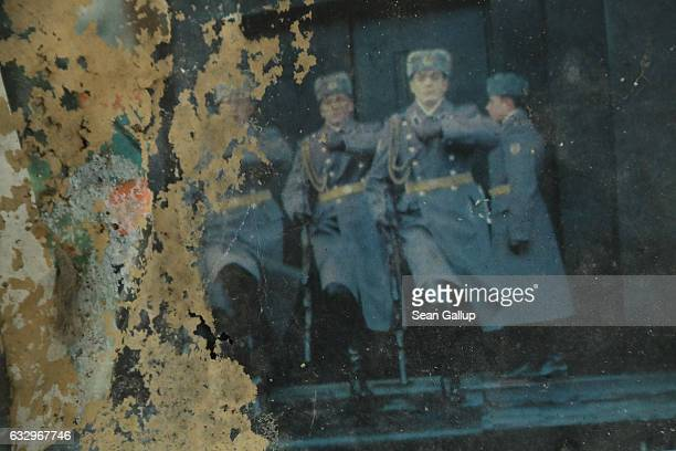 Soviet troops are visible on an ageing Russian calendar on a wall in the officers' building at the former Soviet military base on January 26 2017 in...