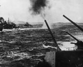 Soviet warships fire their antiarcraft guns in defence of an Allied convoy which is being attacked by German aircraft near a Russian port in the...