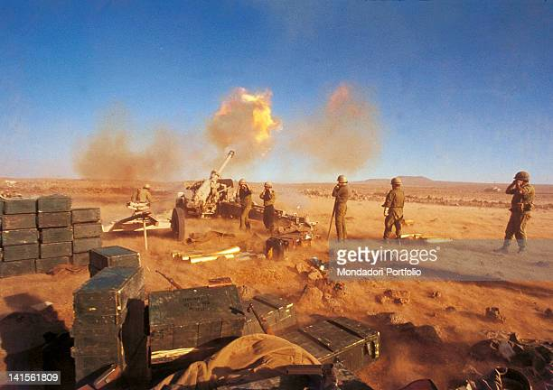 A Sovietmade tank seized by Israeli soldiers in the war of 1967 is attacking the Syrian positions Syria occupied territories October 1973