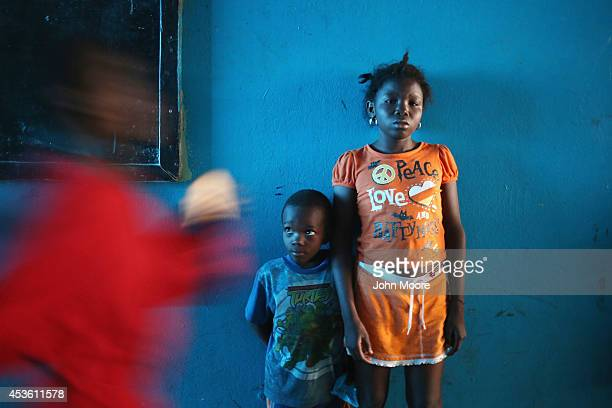 Sowe who's mother says she is 15 and another child stand in a newlyopened Ebola isolation center set up in a school closed due to the epidemic on...
