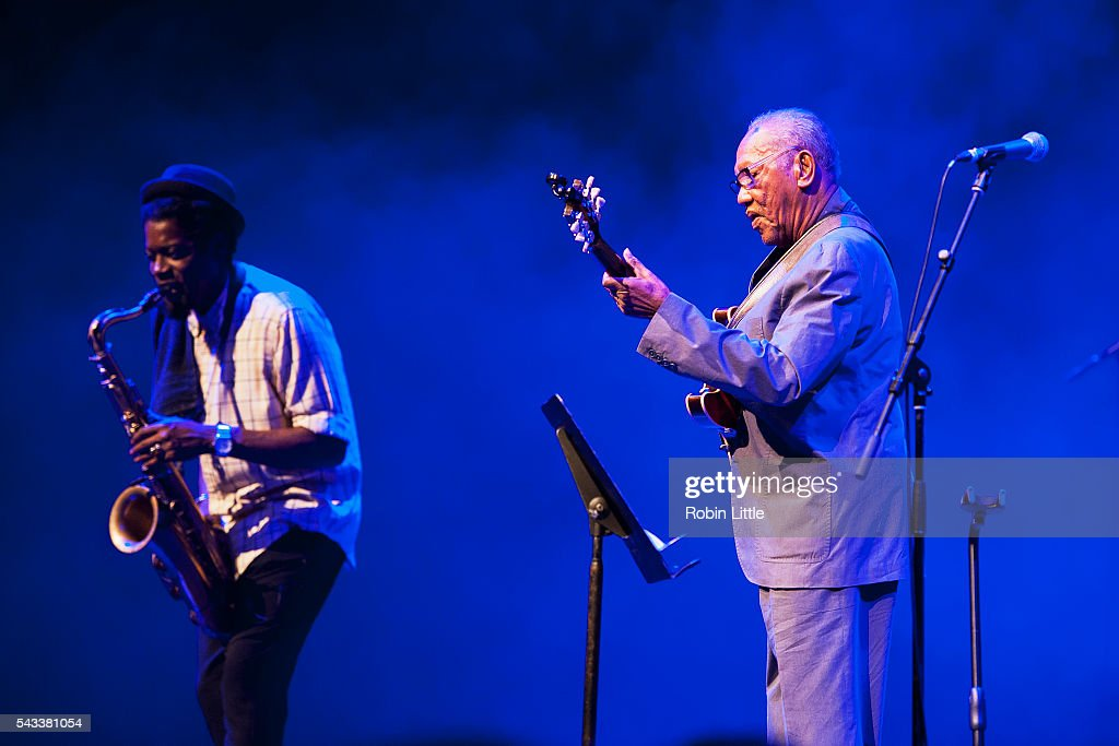 Soweto Kinch and <a gi-track='captionPersonalityLinkClicked' href=/galleries/search?phrase=Ernest+Ranglin&family=editorial&specificpeople=4647588 ng-click='$event.stopPropagation()'>Ernest Ranglin</a> perform at Barbican Centre on June 27, 2016 in London, England.