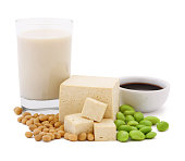 Soy Products - tofu, soy milk glass, soy beans, edamames and soy sauce isolated on white