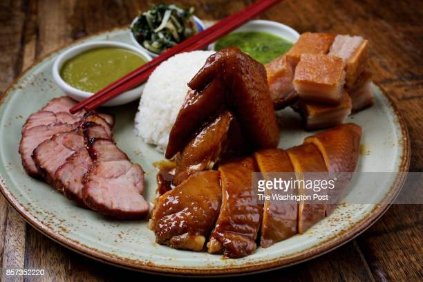 WASHINGTON DC Soya chicken Slow Poached Chicken Crispy Pork Belly Char Siu Steamed rice and Chow chow salad at Tiger Fork photographed in Washington...