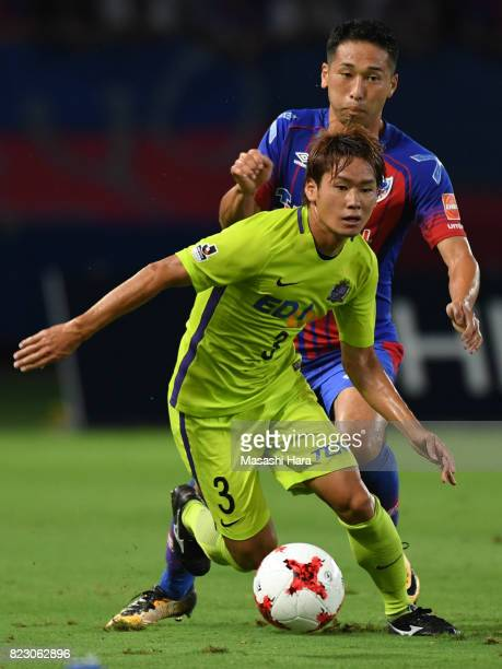 Soya Takahashi of Sanfrecce Hiroshima and Yuhei Tokunaga of FC Tokyo compete for the ball during the JLeague Levain Cup PlayOff Stage first leg match...