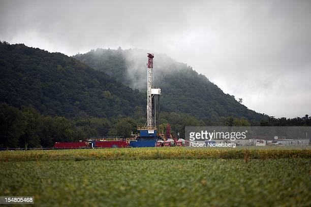 A soybean field lies in front of a natural gas drilling rig September 8 2012 in Fairfield Township Pennsylvania The area sits above the Marcellus...