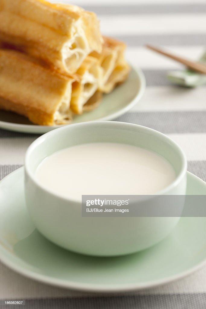 Soybean milk and fried sticks : Stock Photo
